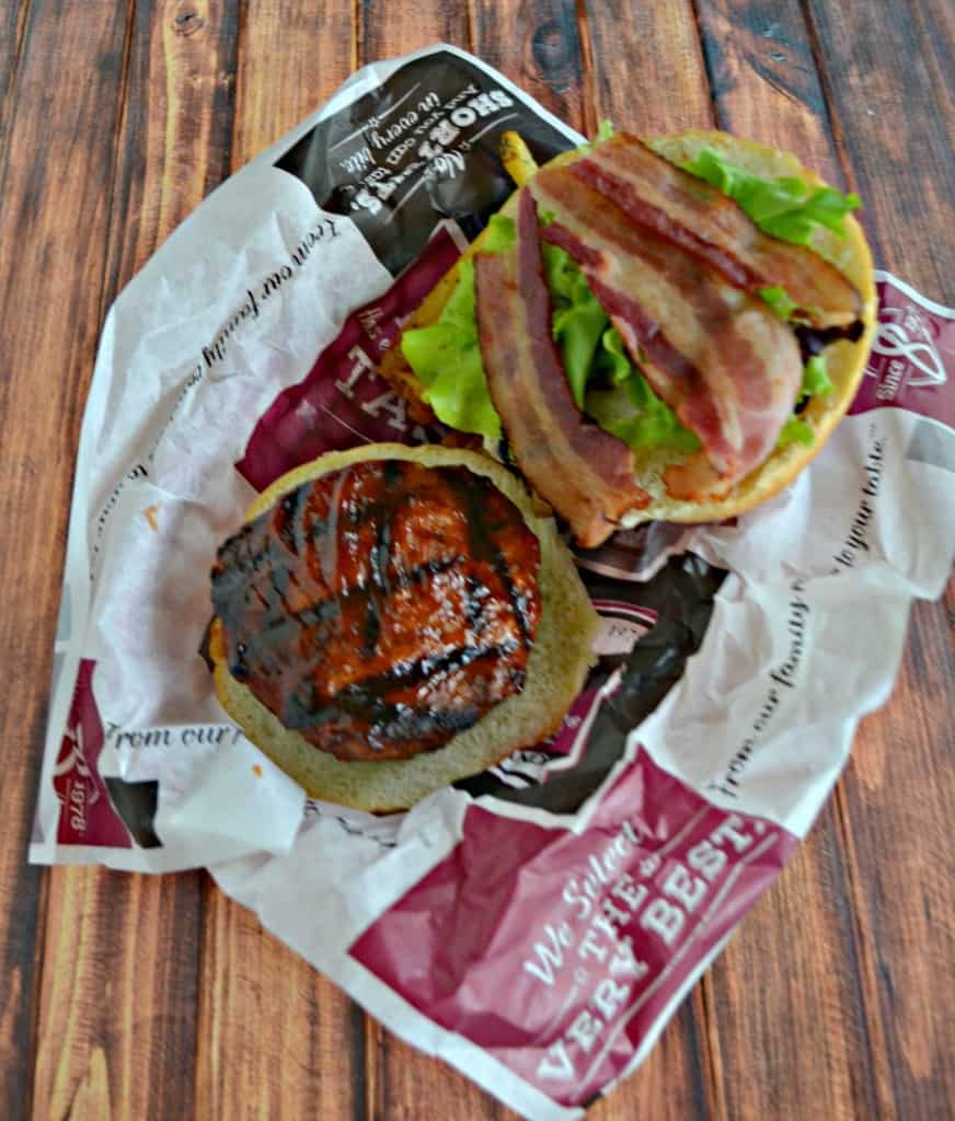 Jalapeno Cheddar Stuffed Burgers brushed with BBQ Sauce and topped with bacon and lettuce