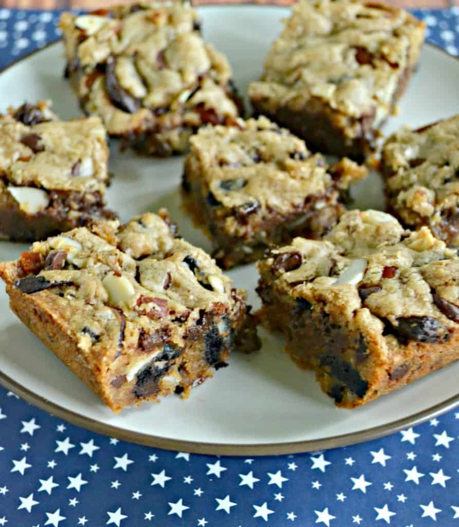 Bite into these delicious Compost Cookie Bars filled with chocolate, nuts, toffee, and cookies!
