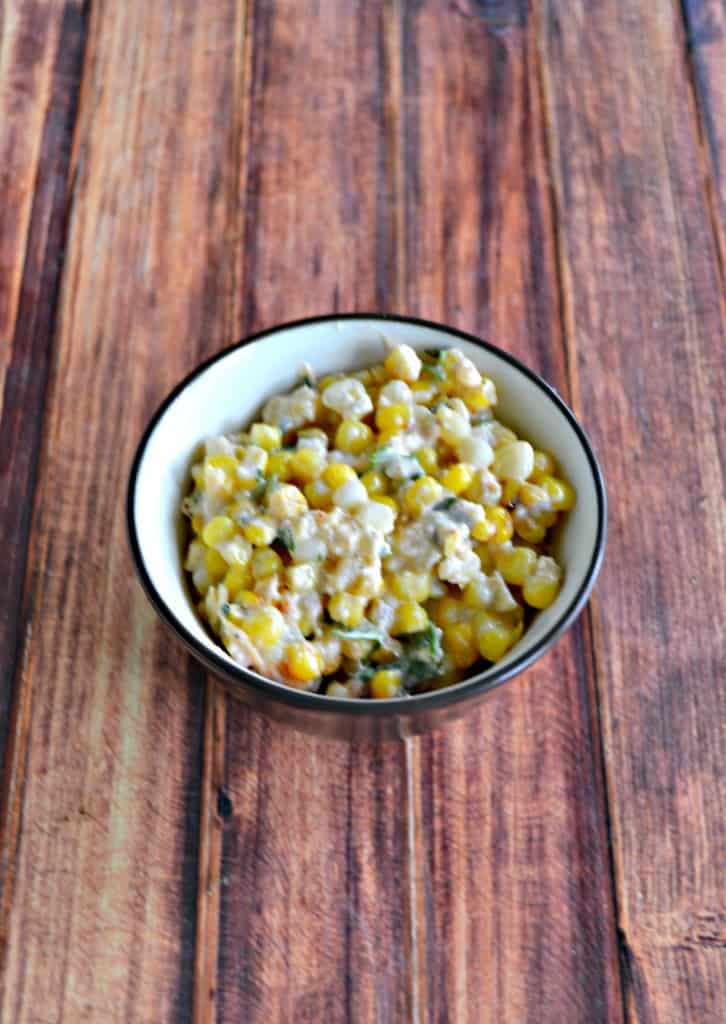 Fresh corn, Mexican cheese, cilantro, and lime juice make an awesome Mexican Corn Salad