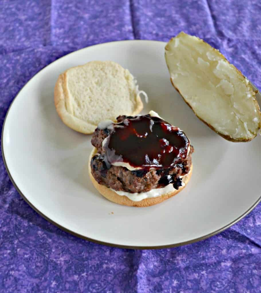 Burgers with Blueberry BBQ Sauce, Brie, and Lemon Shallot Aioli is a flavorful burger!