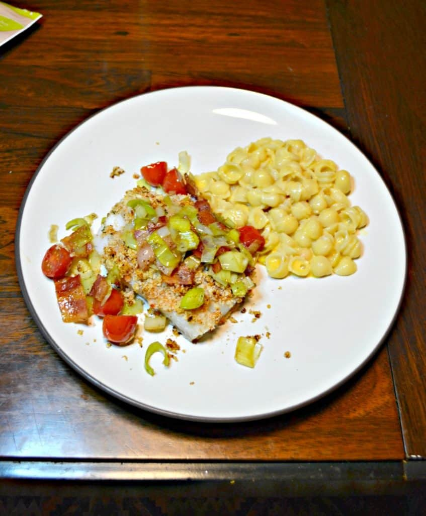 Looking for a flavorful baked fish recipe? Check out this Deviled Breadcrumb Fish with Leeks, Bacon, and Tomatoees