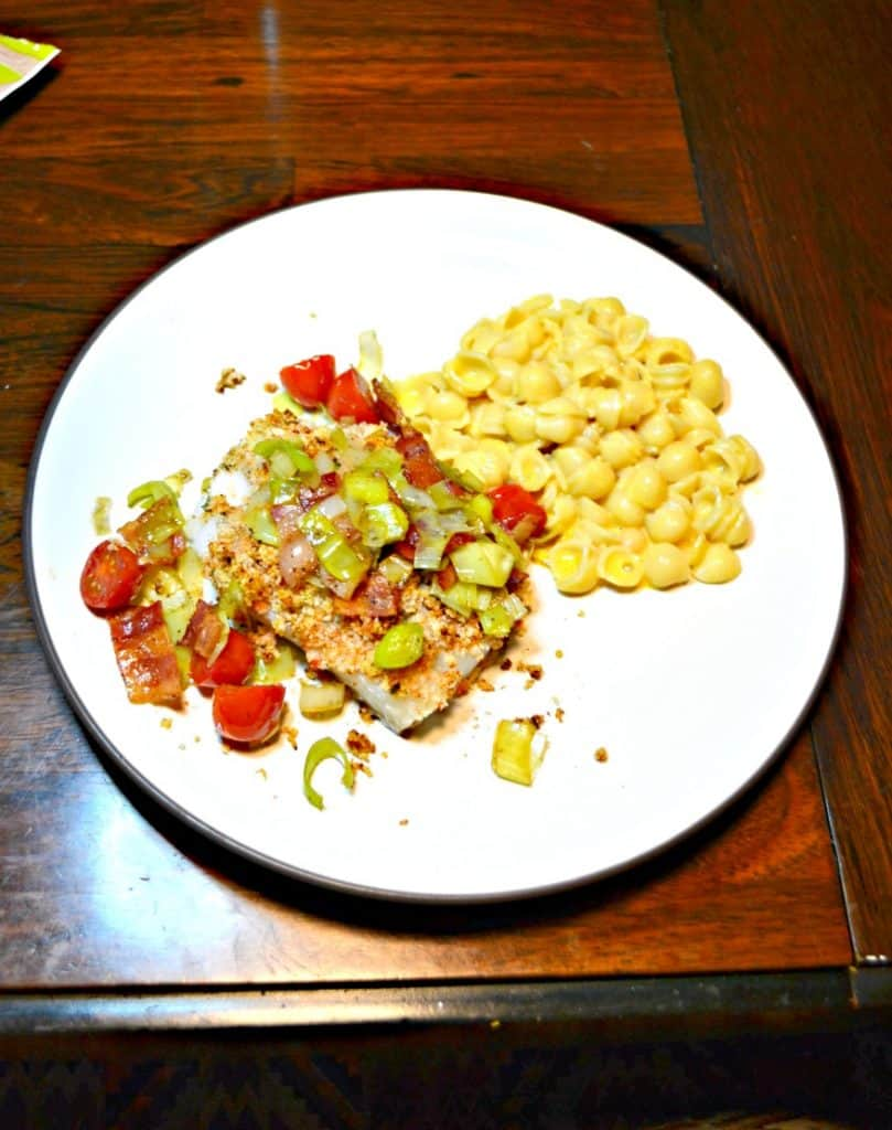 Deviled Breadcrumb Fish with Bacon, Leeks, and Tomatoes is a flavorful meal