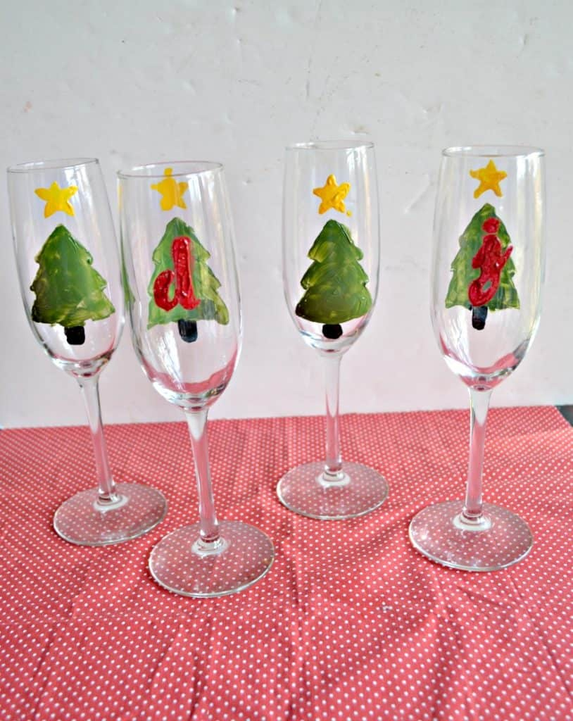 Looking for a fun holiday gift? Make these DIY Hand Paint Holiday Champagne Glasses!