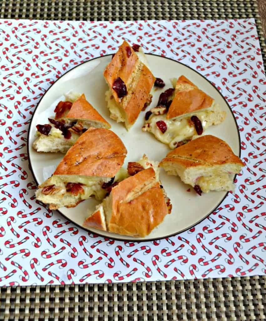 Grab yourself a plate and enjoy this Baked Brie, Bacon, and Cranberry Pull Apart Bread