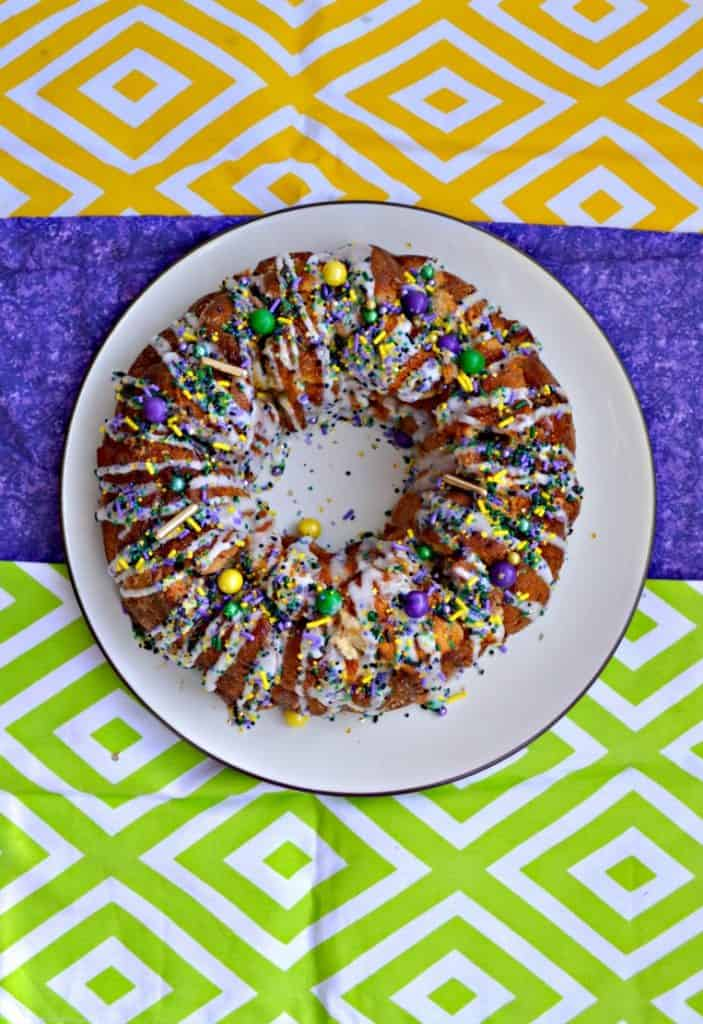 I love these fun sprinkles and cream cheese drizzle on this Mardi Gras Monkey Bread King Cake!