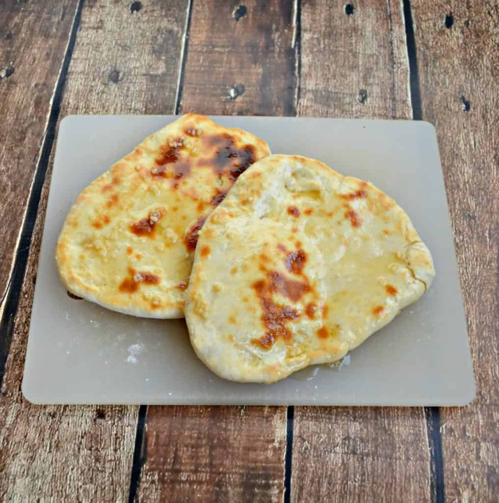Naan is a flatbread baked in the oven and brushed with butter
