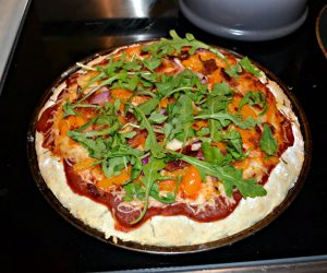Pizza with Red Onion, Bacon, Peppers, and Arugula
