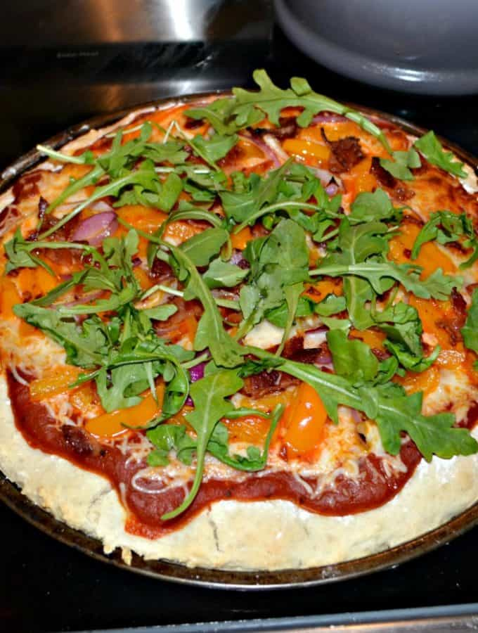 Enjoy a delicious gourmet pizza at home with Peppers, Bacon, Red Onions, and Arugula