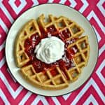 Wake up to these incredible Vanilla Bean Waffles with Strawberry Sauce