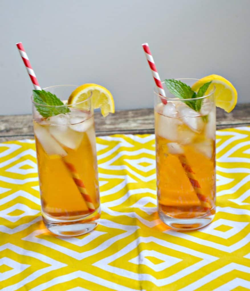 Lookking for a refreshing summer sipper? This Sparkling Peach Iced Tea will hit the spot!