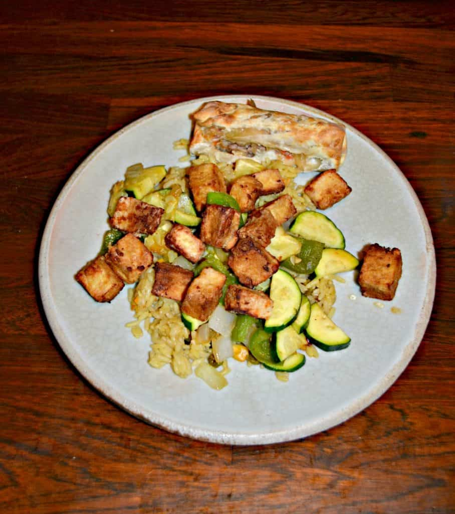 Air Fryer Crispy Tofu with sauteed veggies over rice