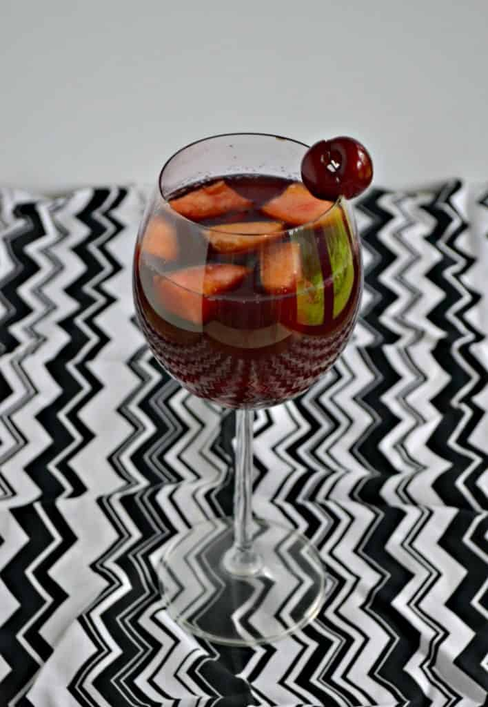 Peach Cherry Sangria is lightly sweetened and full of fruity flavors.