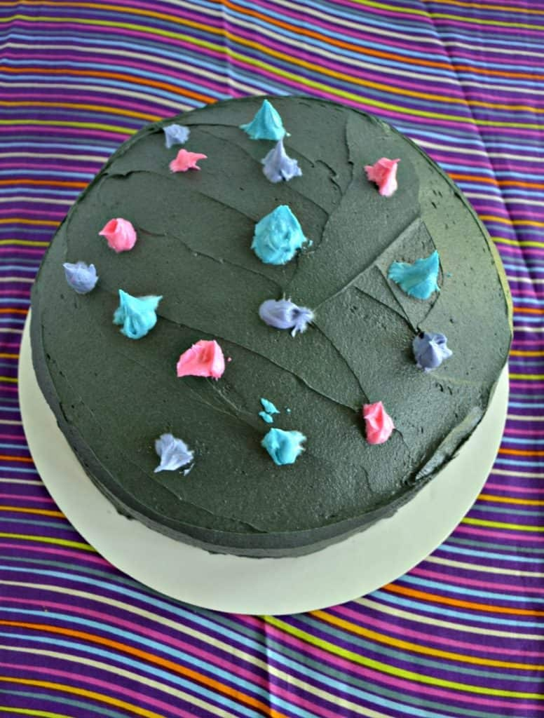 Putting colorful dots of frosting on a black frosted cake makes an awesome galaxy cake!