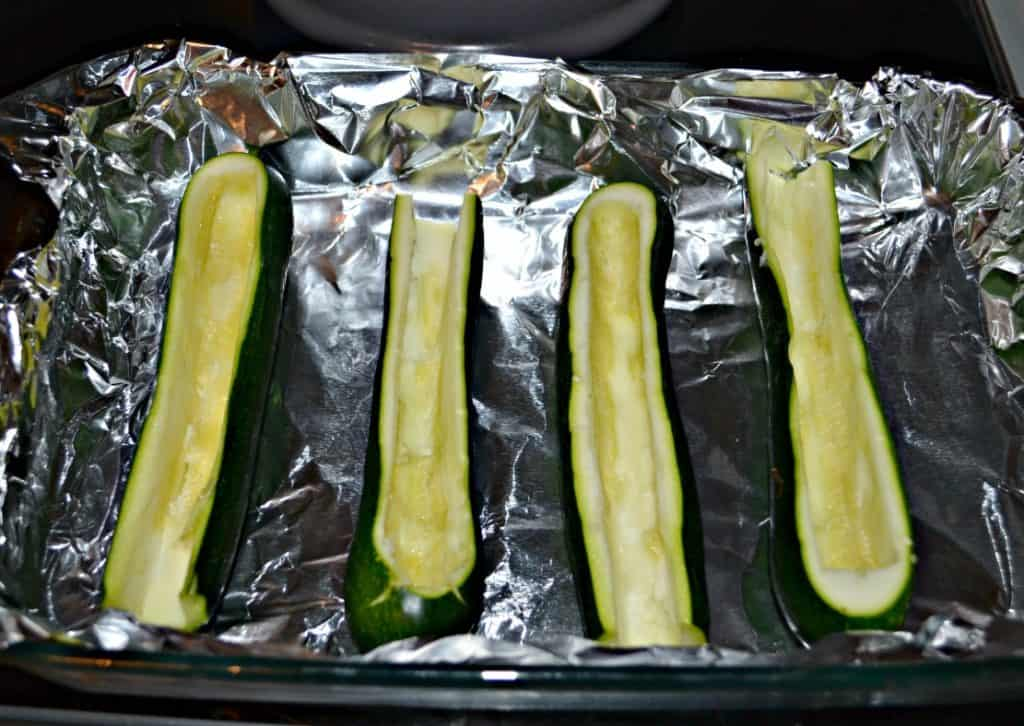 Scoop out the centers of zucchini to make Sausage Stuffed Zucchini Boats