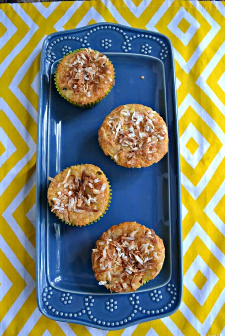Get a taste of the tropics with these Banana, Papaya, and Passion Fruit Muffins topped with toasted coconut.