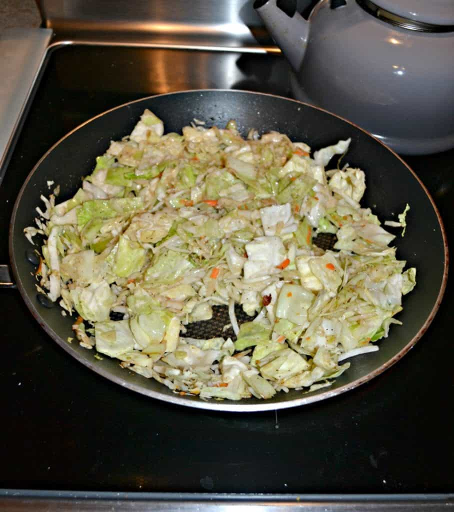 Adding cabbage to any dish is a cheap and filling option like in this Kielbasa and Cabbage Skillet with Buttered Rice