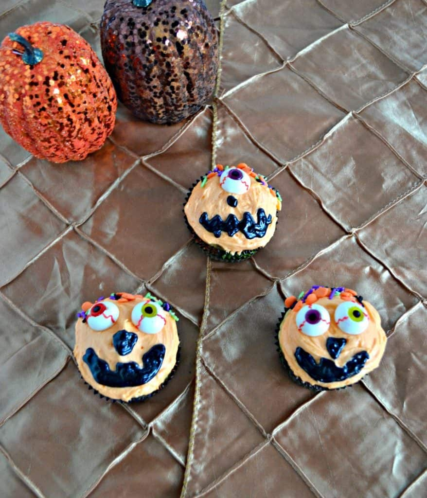 Grab some fun eyeballs and candies and make these Caramel Swirl Silly Pumpkin Cupcakes for Halloween!