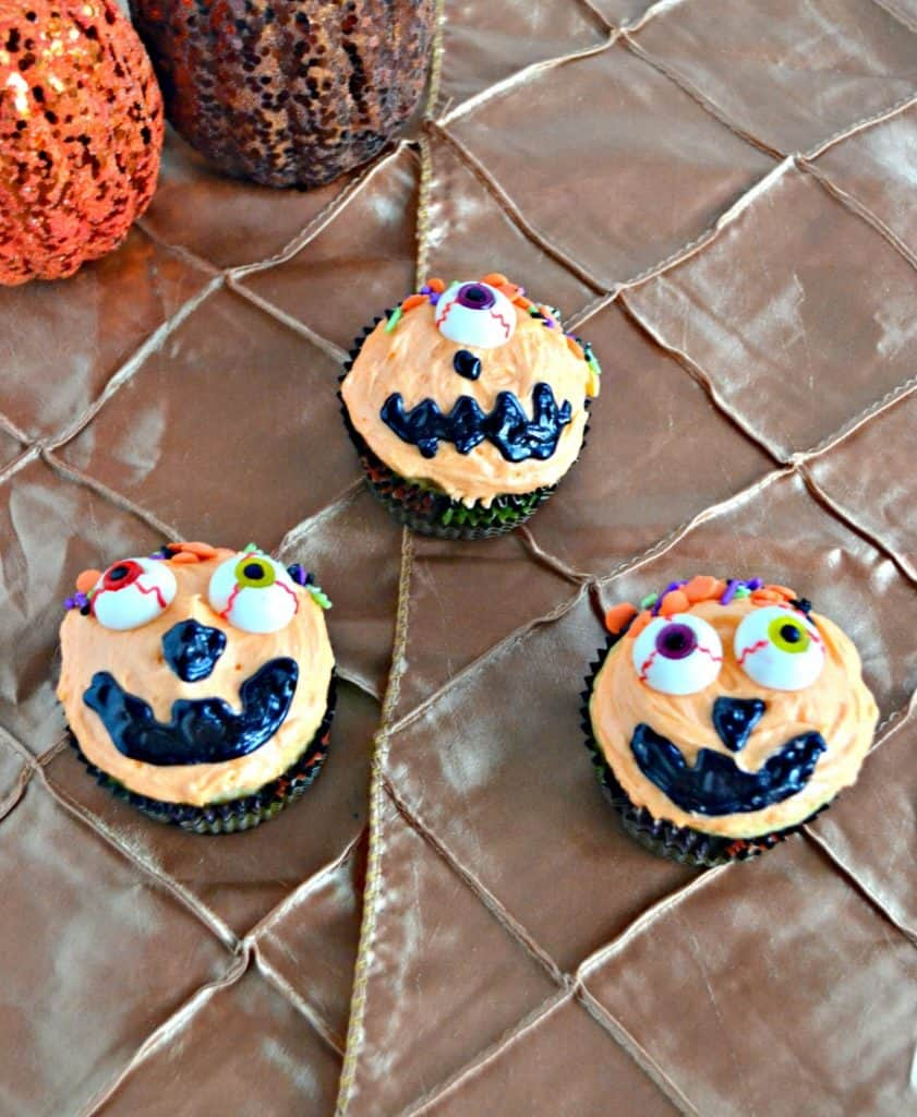 Have a little one that loves to help? Have them help you decorate these Caramel Swirl Silly Pumpkin Cupcakes!