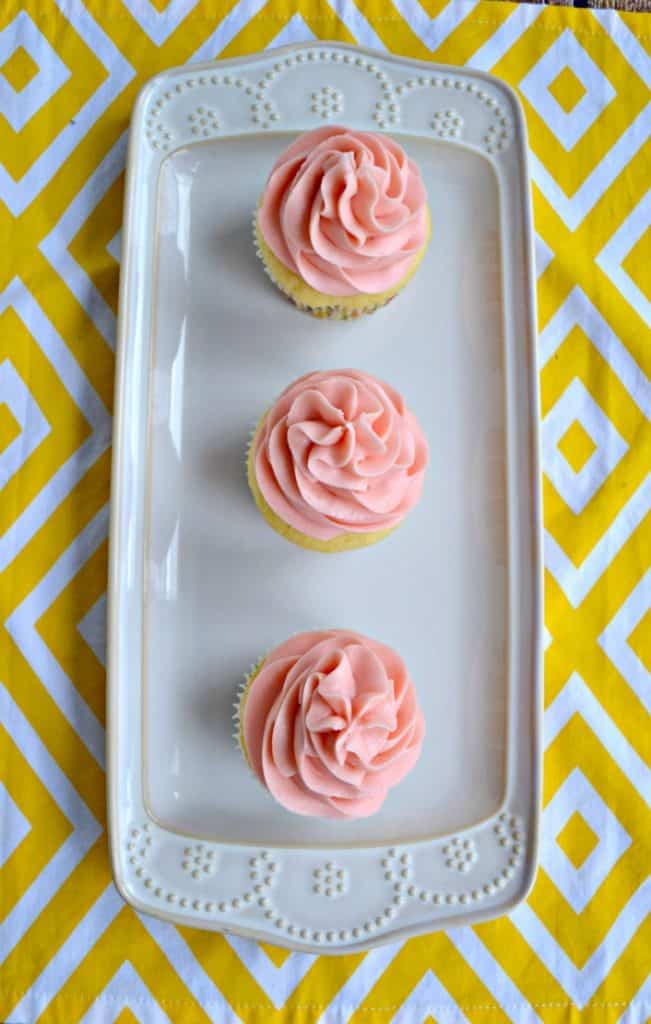 Lemon cupcakes with pink strawberry frosting