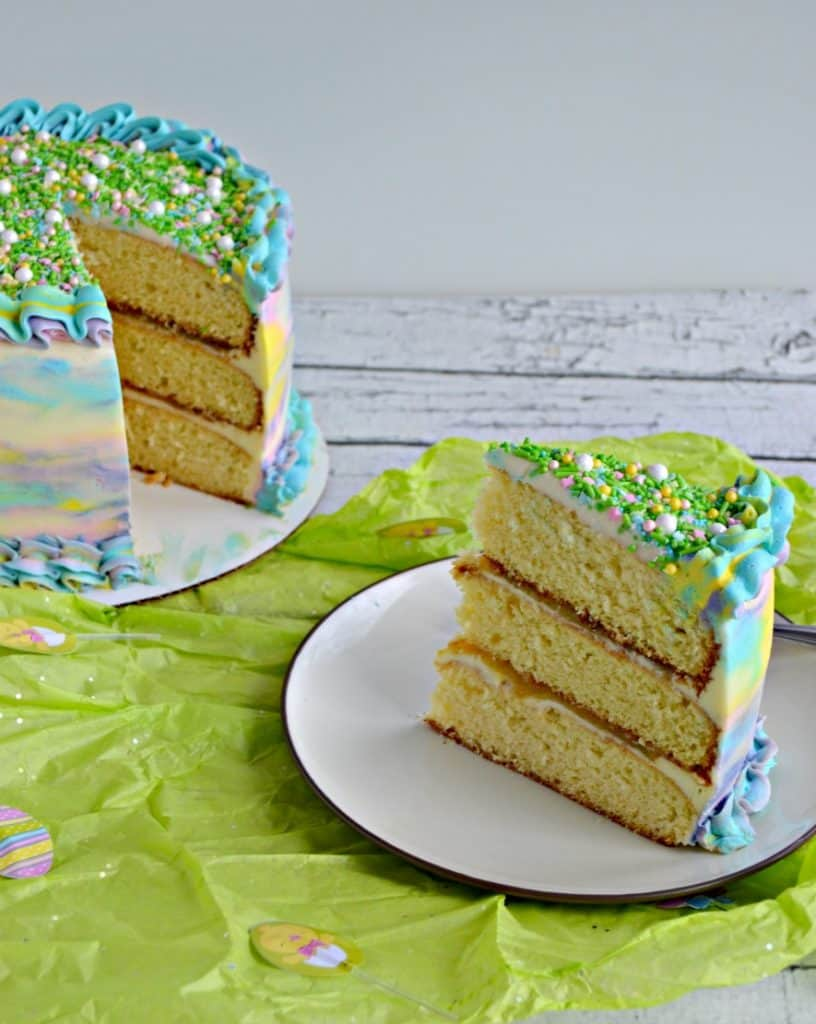 A slice of Spring Watercolor Triple Layer Cake