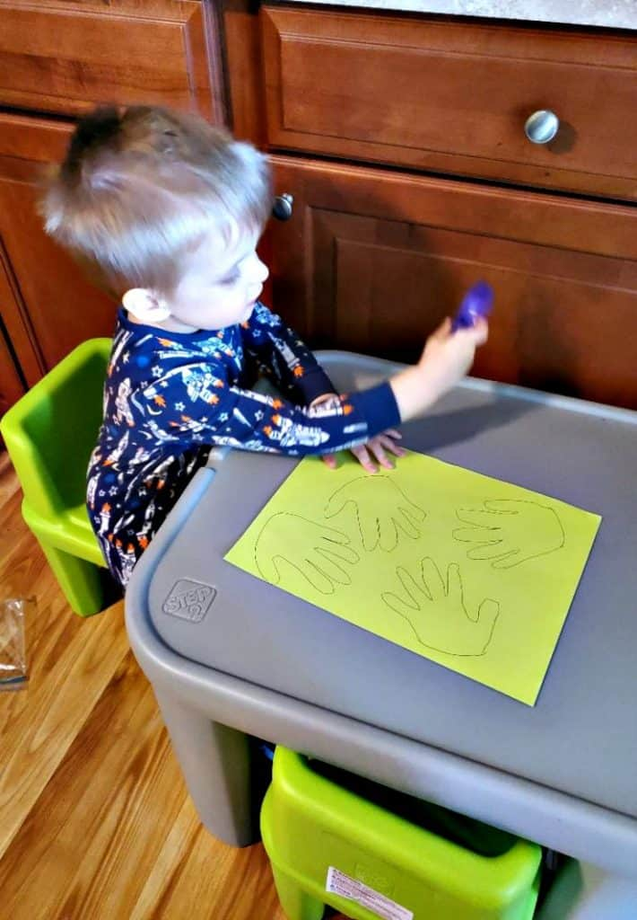 Tracing handprints for an Easy Carrot Craft