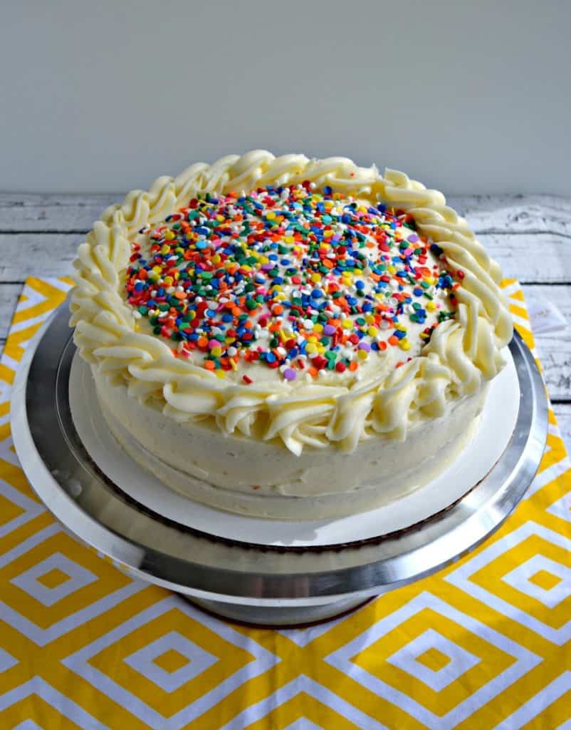 Cake with buttercream frosting and sprinkles