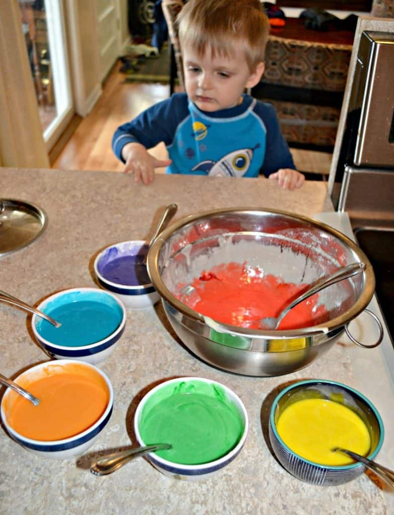 My toddler mixing up Tie Dye Cake