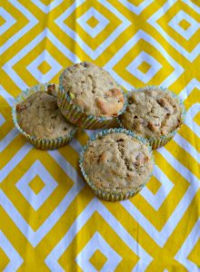 4 hummingbird muffins stacked on a yellow and white placemat