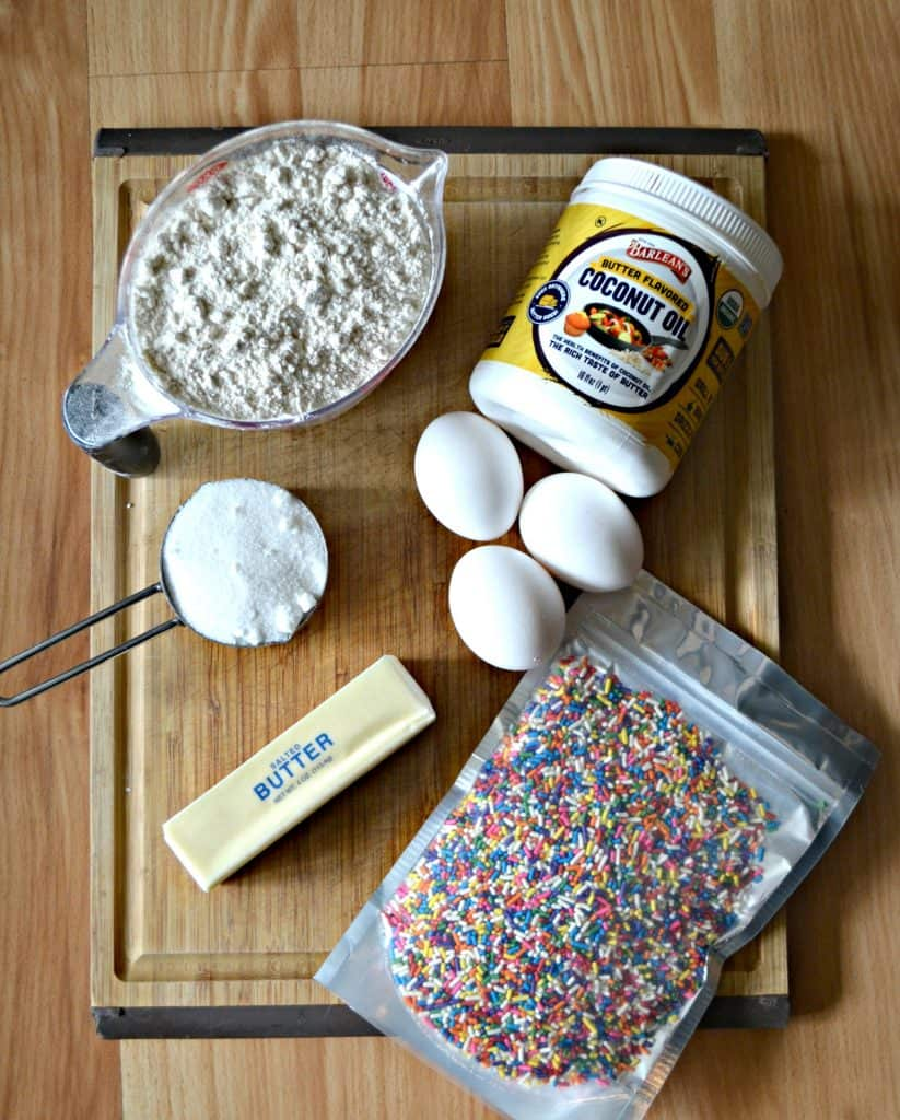 Ingredients for Rainbow Sprinkle Biscotti on a cutting board