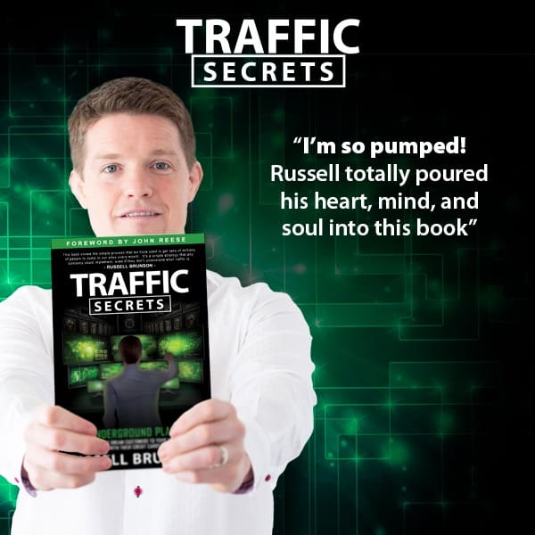 Russell Brunson holding a copy of his book, Traffic Secrets with a green background and text overlay