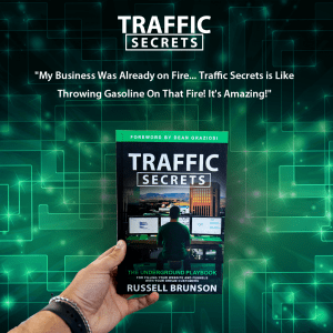 An image of a hand holding the Traffic Secrets Book with text overlay and a green background