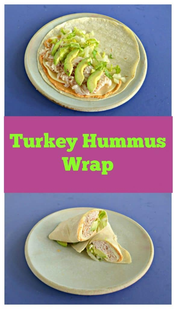 Pin Image: A plate with a wrap on it topped with hummus, turky, lettuce, and avocado slices, text overlay, a turkey wrap on a plate, cut in half and sstacked on top of each other.