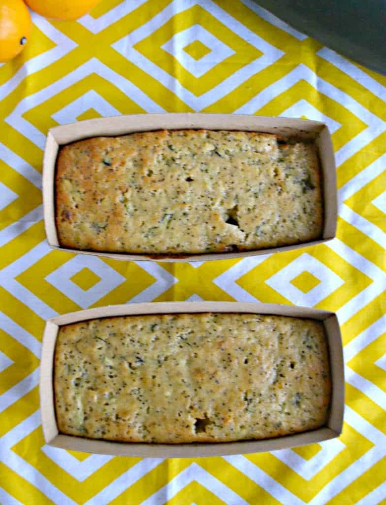 Two mini loaves of lemon poppyseed zucchini bread on a yellow and white placemat.