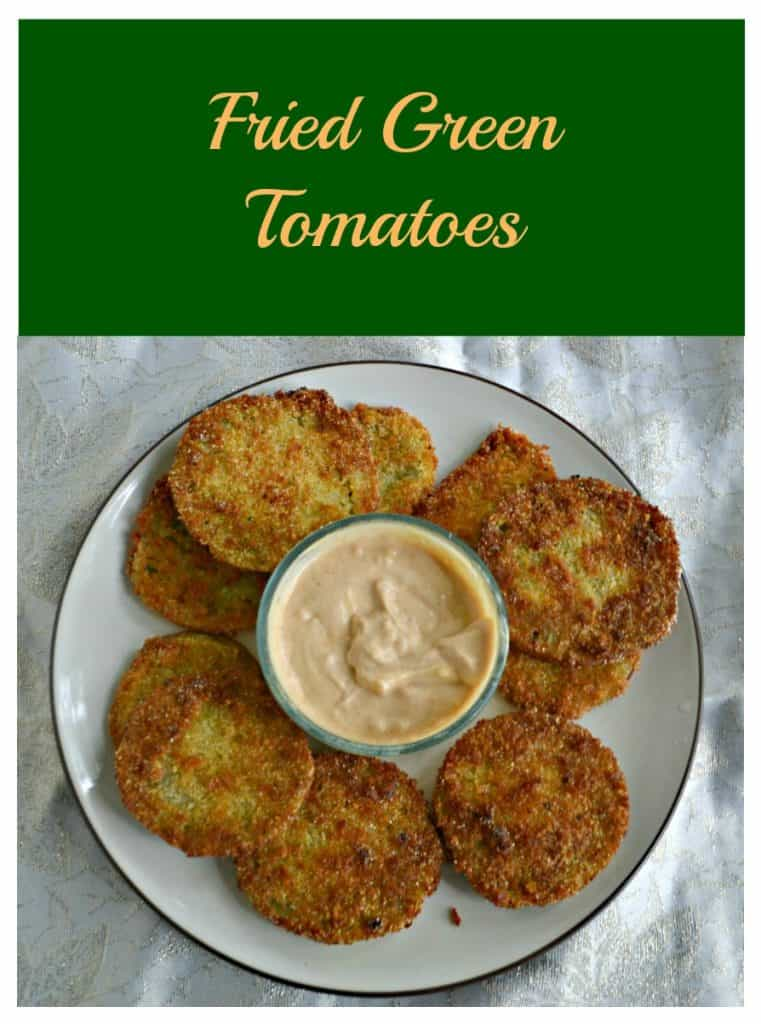 Pin Image: text overlay, a plate topped with golden brown fried green tomatoes and a bowl of remoulade in the middle.