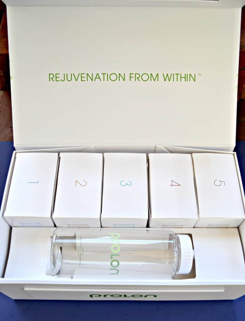 A white box with 5 smaller boxes numbered 1-5 inside and a clear water bottle.