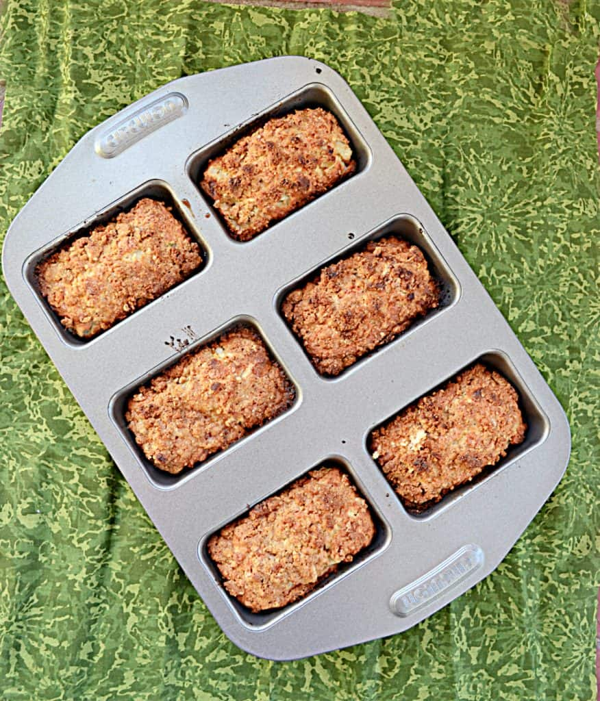 A mini loaf baking pan filled with 6 mini loaves of pear ginger cakes.