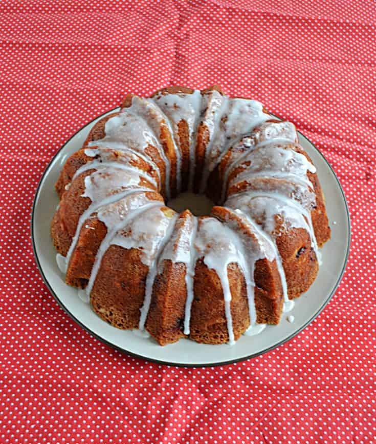 A Bundt cake topped with a lemon glaze.
