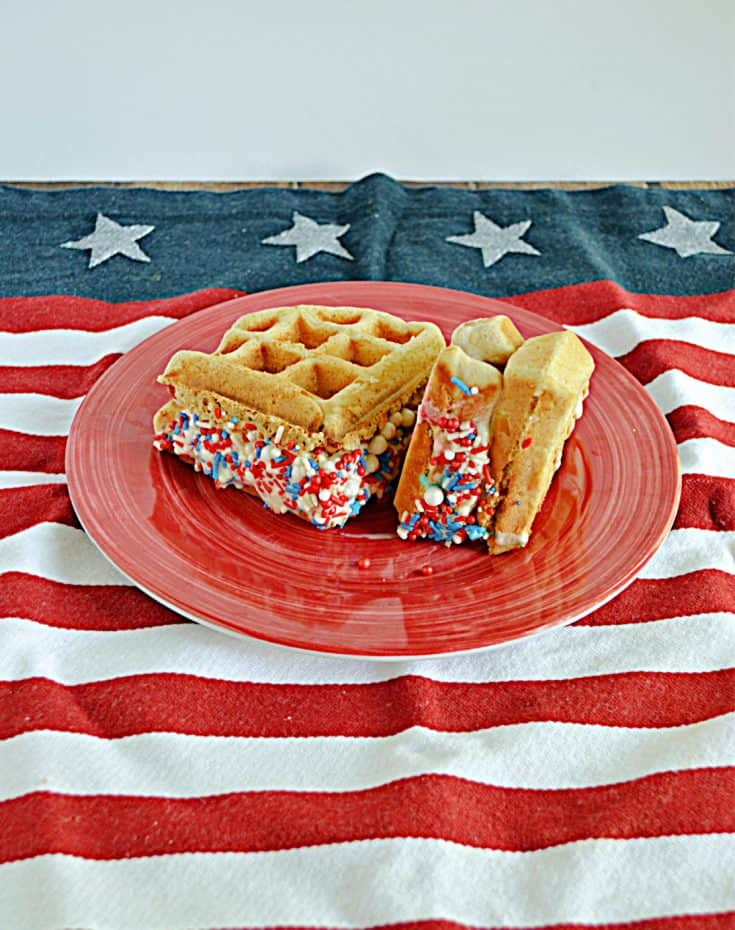 A plate with two waffle ice cream sandwiches rolled in red, white, and blue sprinkles.