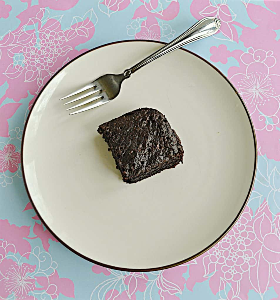 A plate with a chocolate Sourdough Brownie on it along with a fork.