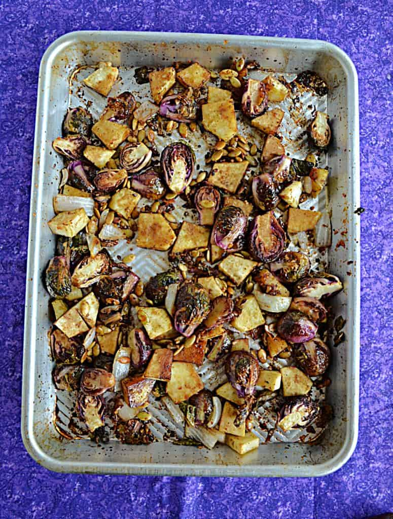 A sheet pan with Brussels Sprouts and Sweet Potatoes.