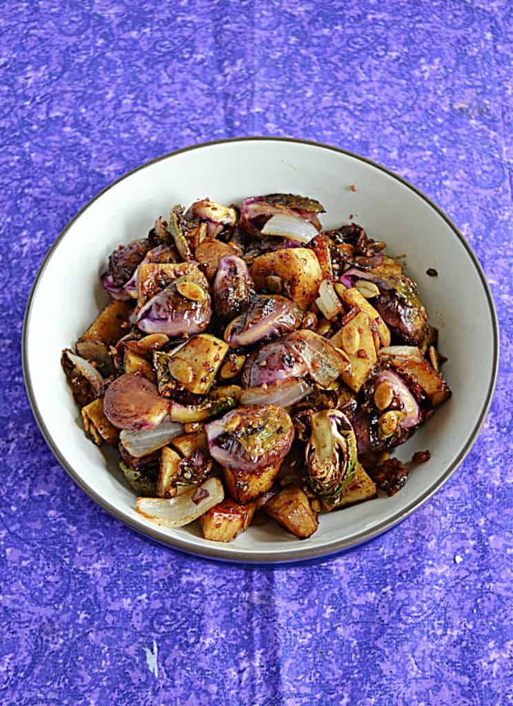 A bowl of Balsamic Brussels Sprouts and Sweet Potatoes.