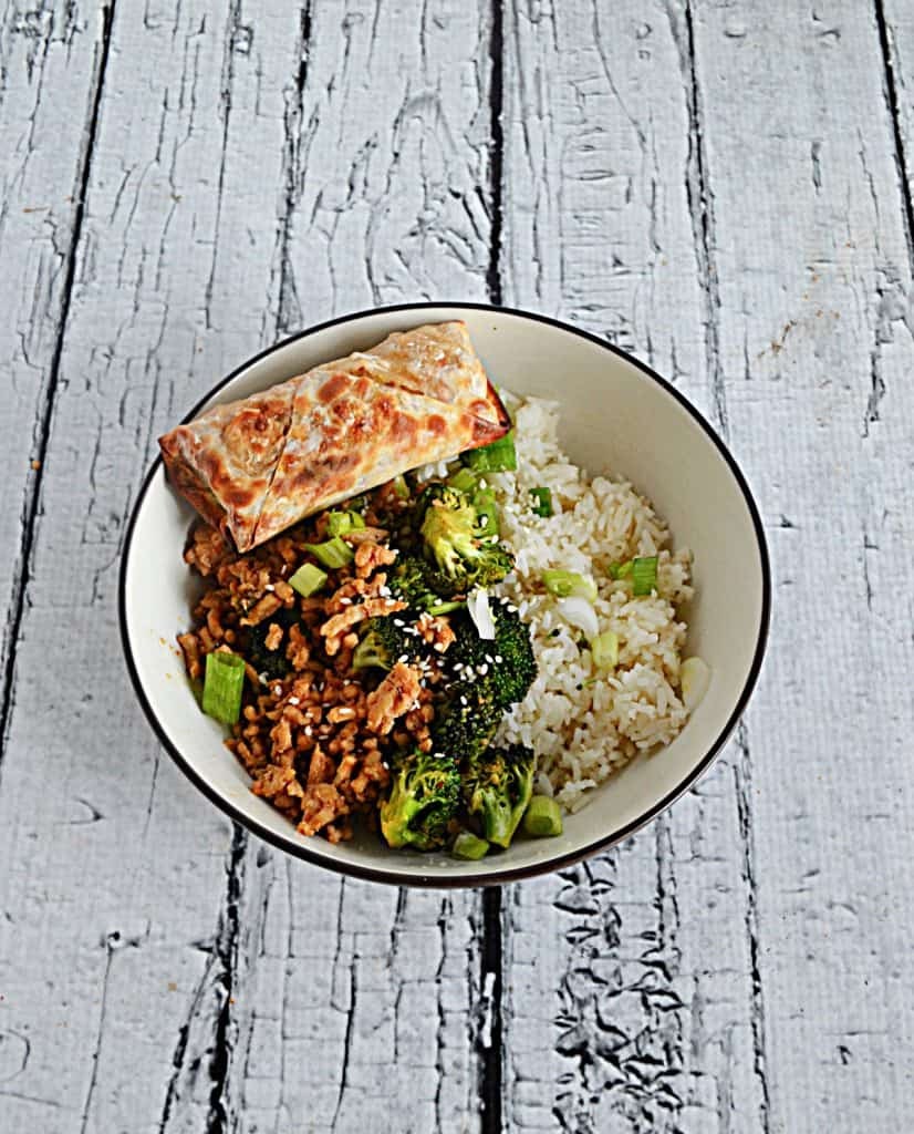A bowl with Honey Srirach Chicken, Broccoli, and Rice