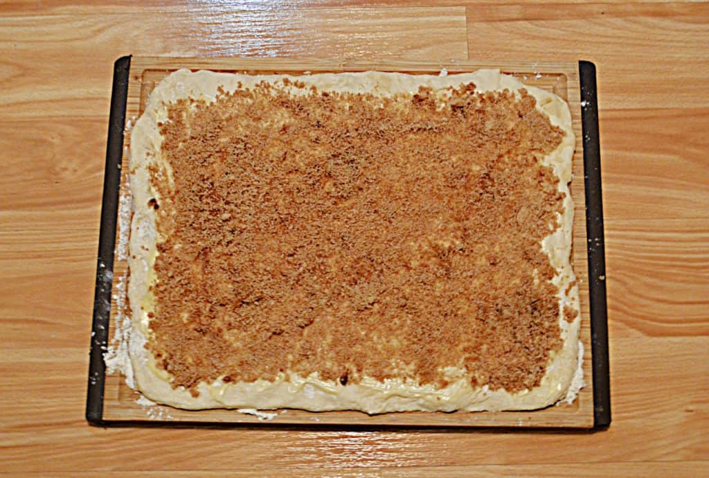 Sourdough rolled out into a rectangle then spread with a cinnamon sugar mixture.